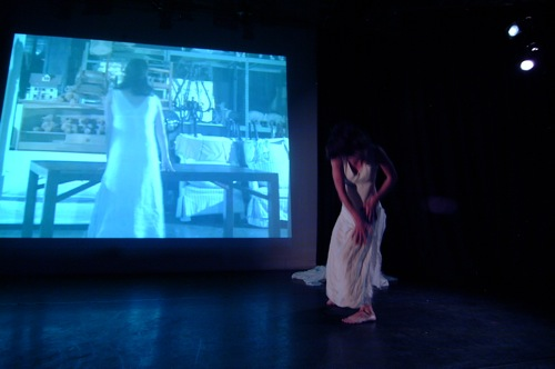 Dani Beauchamp performing <em>Aqua Madora</em> at ″Permanent Wilting″ at Highways in Los Angeles