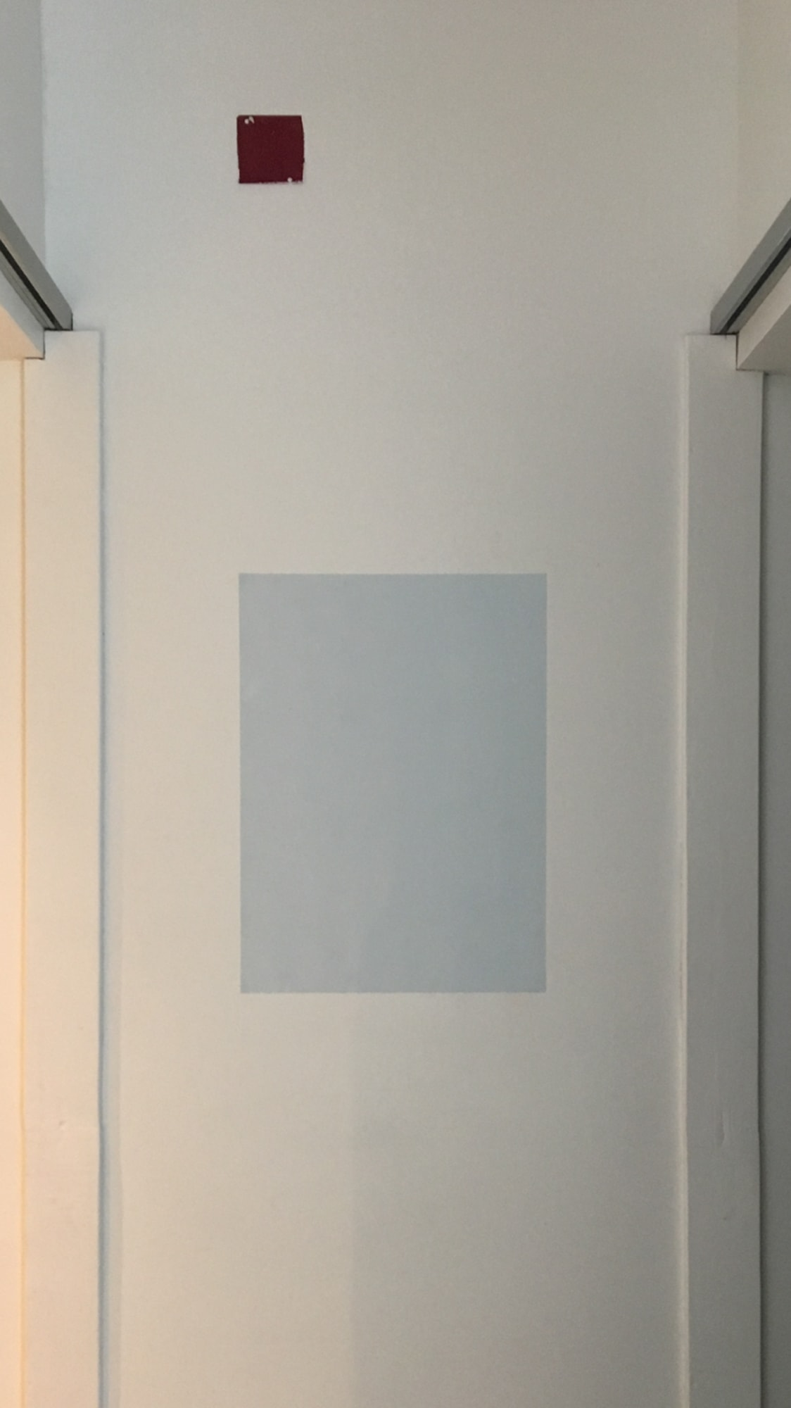 Randy Gibson's <em>Tomorrow Is A New Day</em> installed between the restrooms at Wild Project, NYC