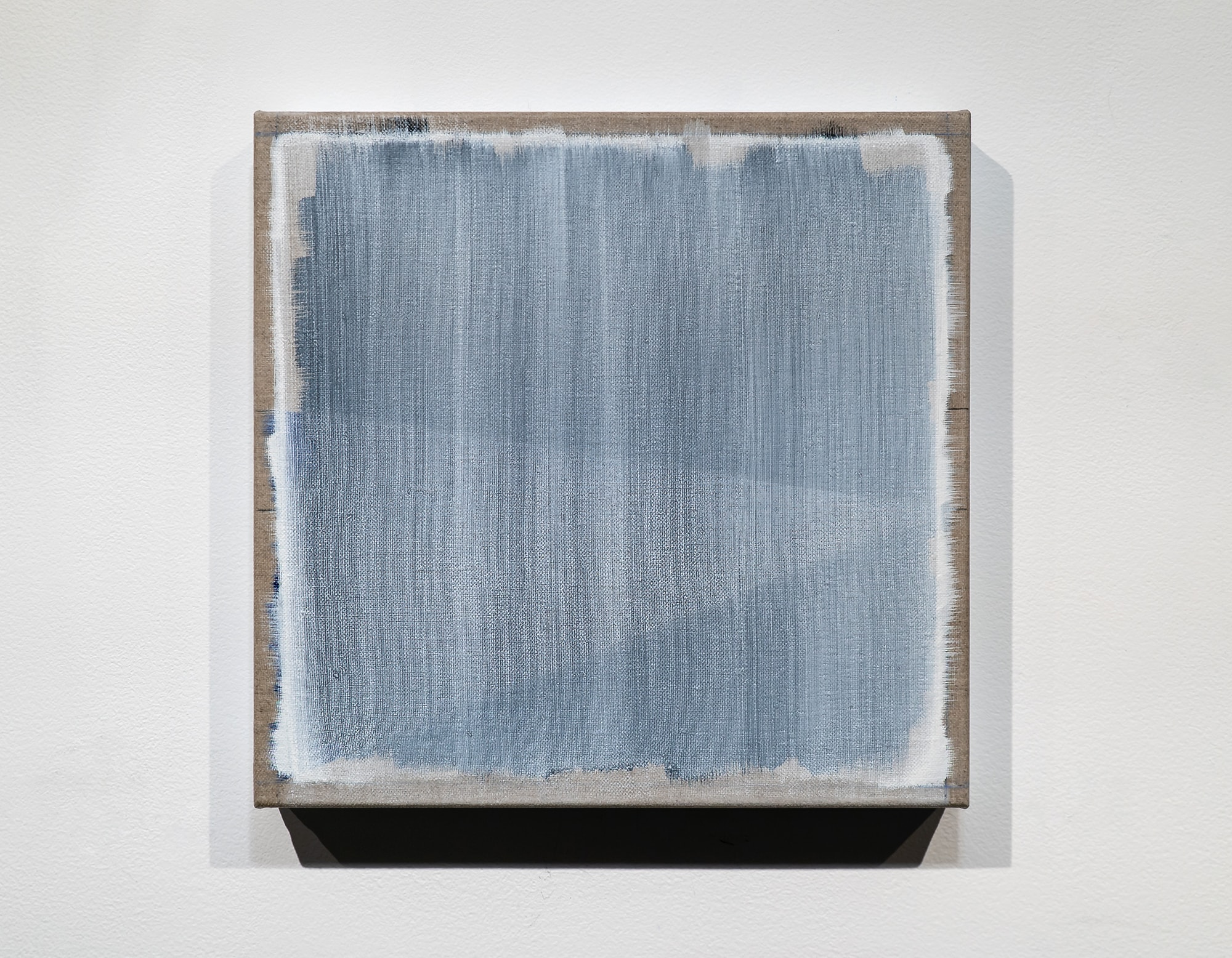 Randy Gibson's <em>Rational Wedge 21:28 (White)</em> | 2018 | 13.5″ x 14″ x 1.5″ | Oil, Acrylic Dispersion, and Chalk on Linen