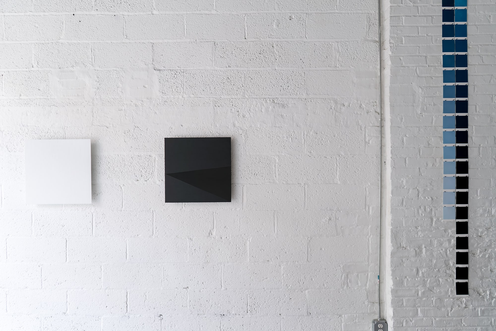 Installation view of Randy Gibson's <em>Rational Time</em>  at the Wild Project Gallery, <em>Available Light Symmetry 17 VIII 21</em> on the right.