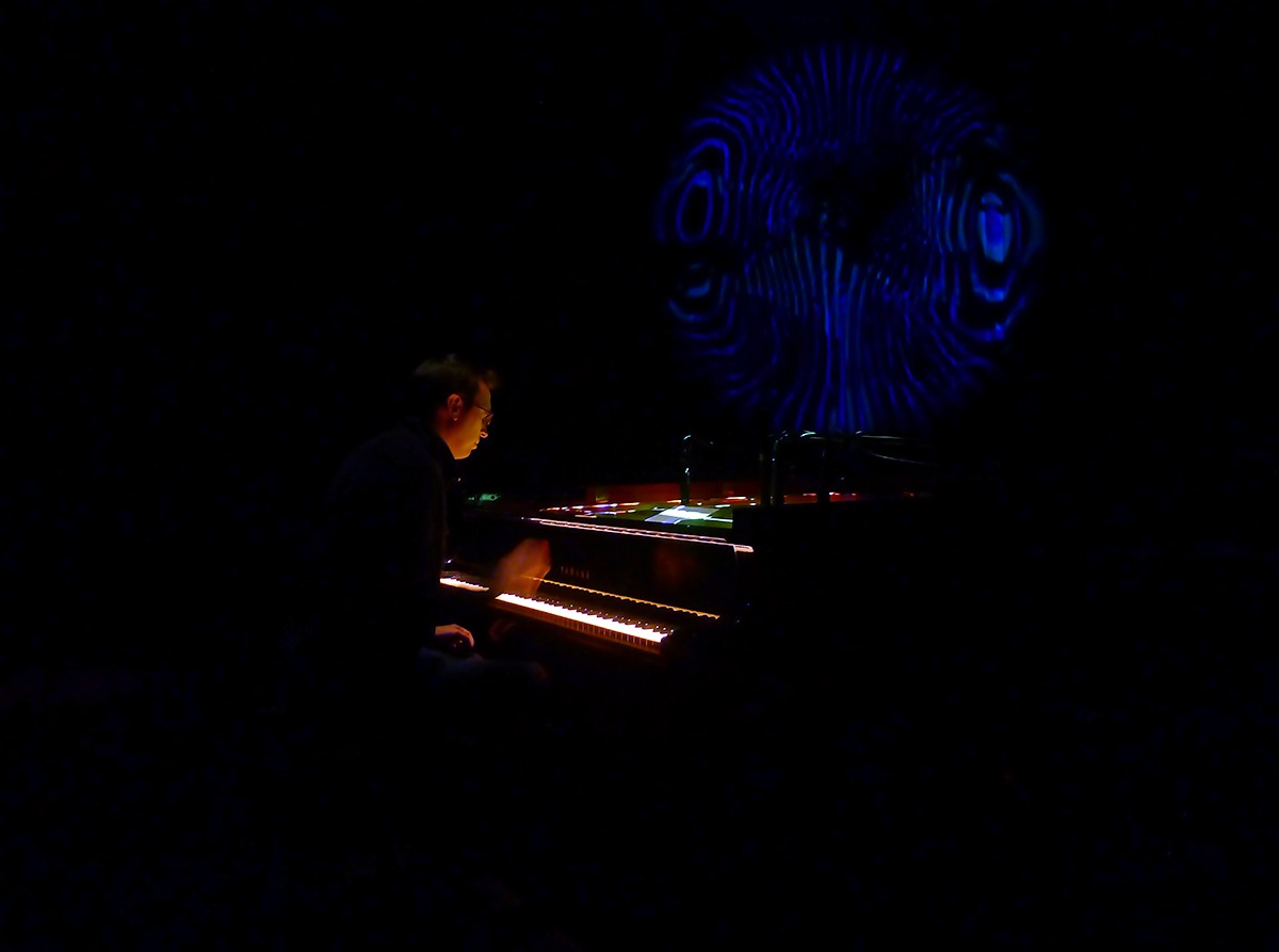 R. Andrew Lee performing Randy Gibson's <em>The Four Pillars Appearing from The Equal D under Resonating Apparitions of The Eternal Process in The Midwinter Starfield</em> at its premiere in 2014
